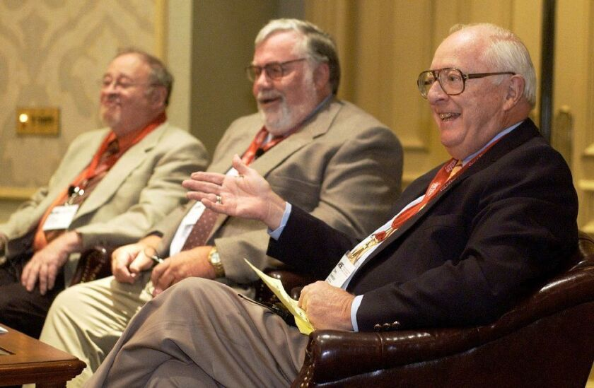 In this June 24, 2004, file photo, Dave Anderson, New York Times sports columnist, right, gestures while on a panel discussion with, from left, Jerry Izenberg, Newark Star-Ledger sports columnist, and Bill Conlin, Philadelphia Daily News sports columnist.