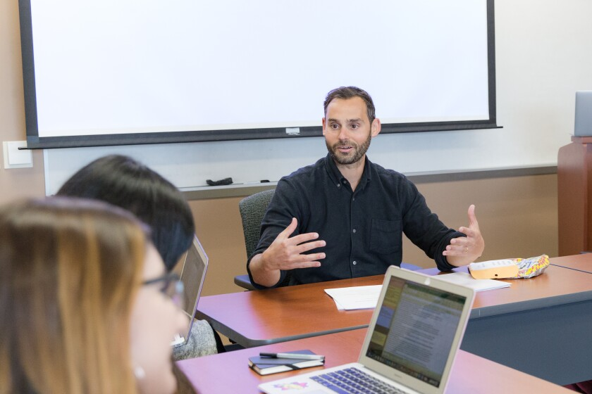 UC Irvine professor Paul Piff teaches a class on the science of compassion.