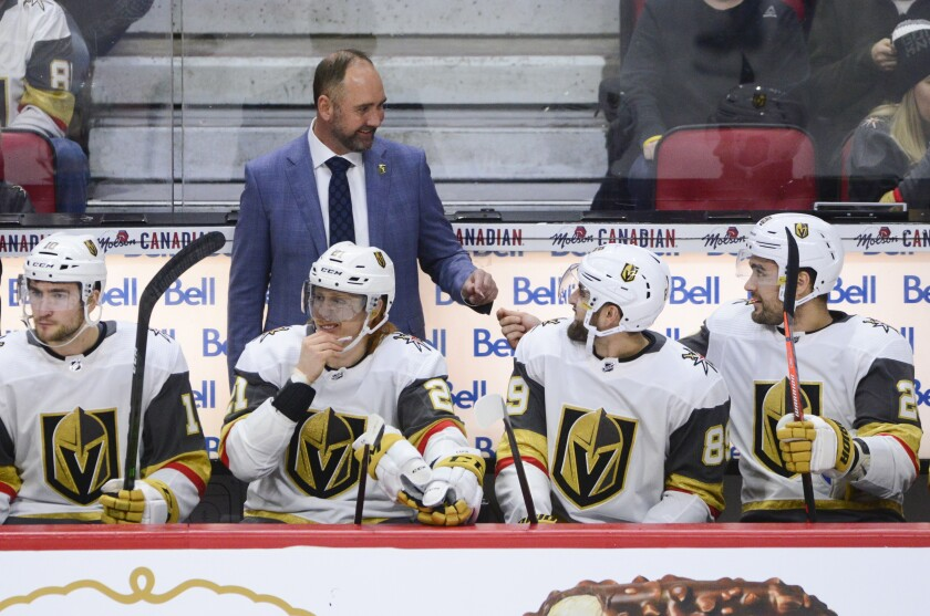 FILE - Vegas Golden Knights head coach Peter DeBoer is seen on the bench as they take on the Ottawa Senators during the first period of an NHL hockey game in Ottawa, in this Thursday, Jan. 16, 2020, file photo. The Golden Knights, the consensus favorites to win the 2021 Stanley Cup, have a longer runway for takeoff than they did before the 2020 playoffs, though they won't have any exhibition games to gauge from.(Sean Kilpatrick/The Canadian Press via AP, File)