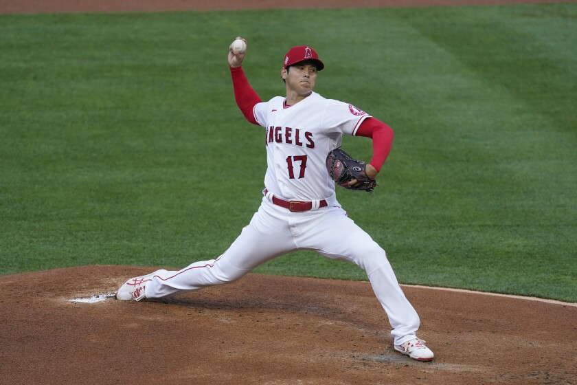 Shohei Ohtani, on the mound, prepares to deliver a pitch.