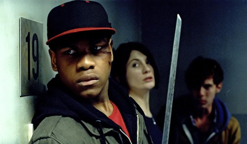 "John Boyega, left, Jodie Whittaker and Luke Treadaway costar in the 2011 sci-fi tale ""Attack the Block."""