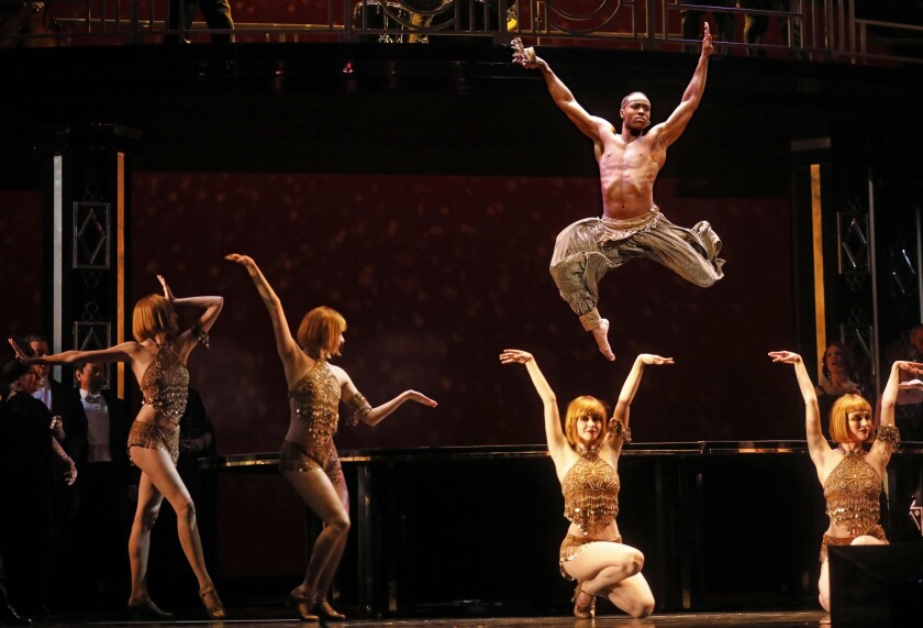 LOS ANGELES, CA - MAY 30, 2019 - - Louis A. Williams, Jr., in air, joins dancers in a scene from Los
