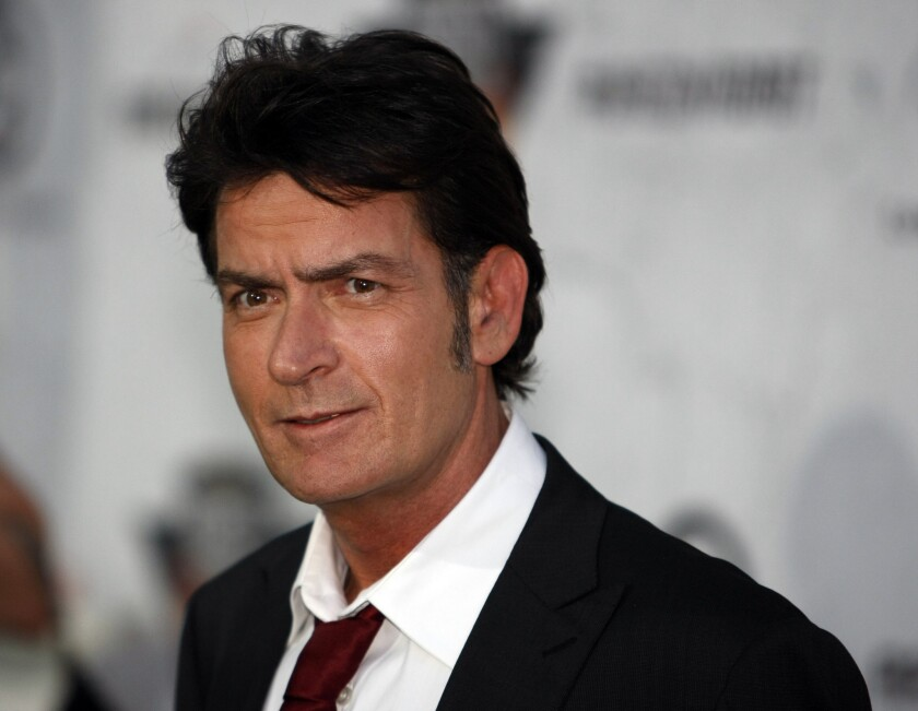 Charlie Sheen's ex-fiancee obtained a temporary restraining order against the star, two days after Los Angeles Police Department officials confirmed that he was under investigation for an alleged threat he made against her.