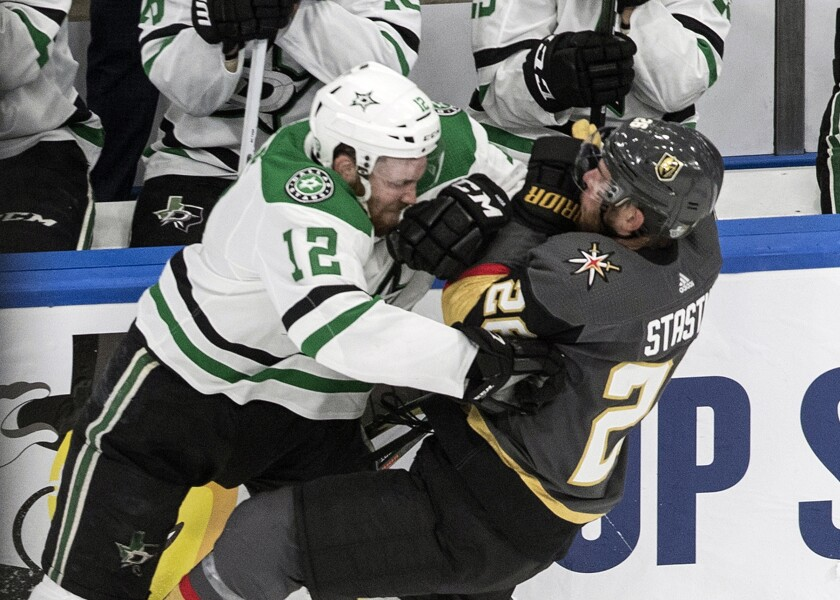 Vegas Golden Knights' Paul Stastny (26) is checked by Dallas Stars' Radek Faksa (12) during the first period of Game 1 of an NHL Western Conference final hockey game, Sunday, Sept. 6, 2020 in Edmonton, Alberta. (Jason Franson/The Canadian Press via AP)