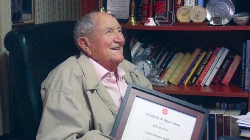Centenarian-Gibbs-smiling-with-award-FI