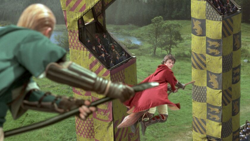 "Harry Potter (Daniel Radcliffe), right, and Draco Malfoy (Tom Felton) on the Quidditch Pitch in ""Harry Potter and the Chamber of Secrets."""
