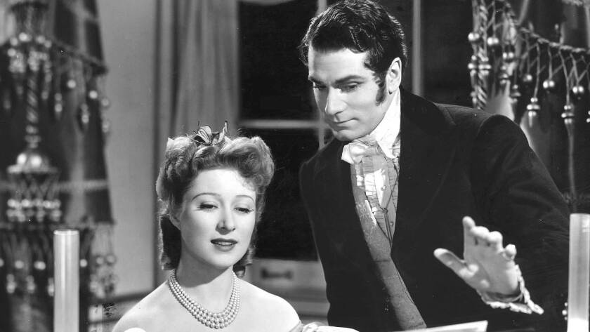 """Laurence Olivier in """"Pride and Prejudice"""" (1940) with Greer Garson."""