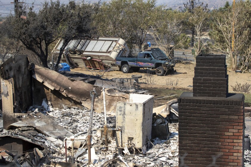 The Bobcat fire has burned through the Angeles National Forest and destroyed this home in Juniper Hills.