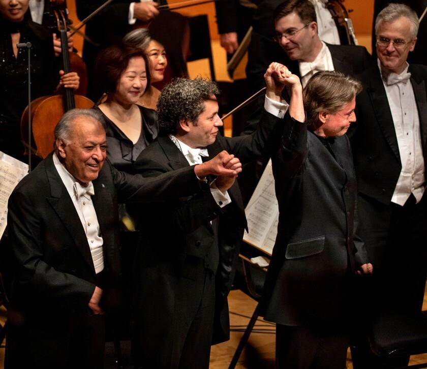 Zubin Mehta, left, Gustavo Dudamel and Esa-Pekka Salonen take a bow at the Disney Hall gala concert Thursday.