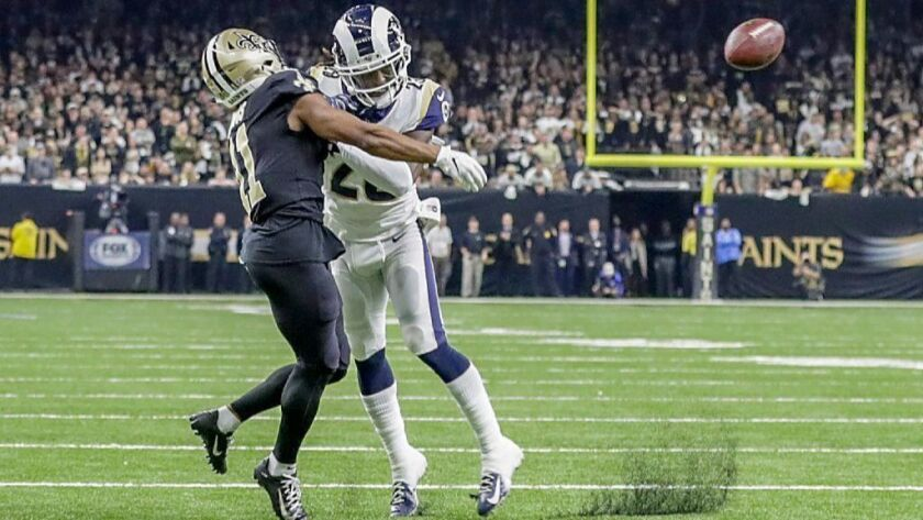Rams cornerback Nickell Robey-Coleman, right, shoves Saints wide receiver Tommylee Lewis, preventing him from making a catch during the fourth quarter of the NFC championship game.