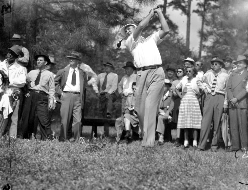 FILE - In this April 4, 1946, file photo, Herman Keiser drives from the third tee at the Masters golf touranment at Augusta National Golf Club in Augusta, Ga. Keiser went on to win the Masters 75 years ago this week. (AP Photo/File)