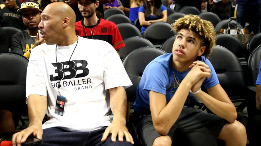 LaVar Ball and son LaMelo watch the Big 3 tournament this summer at Staples Center.