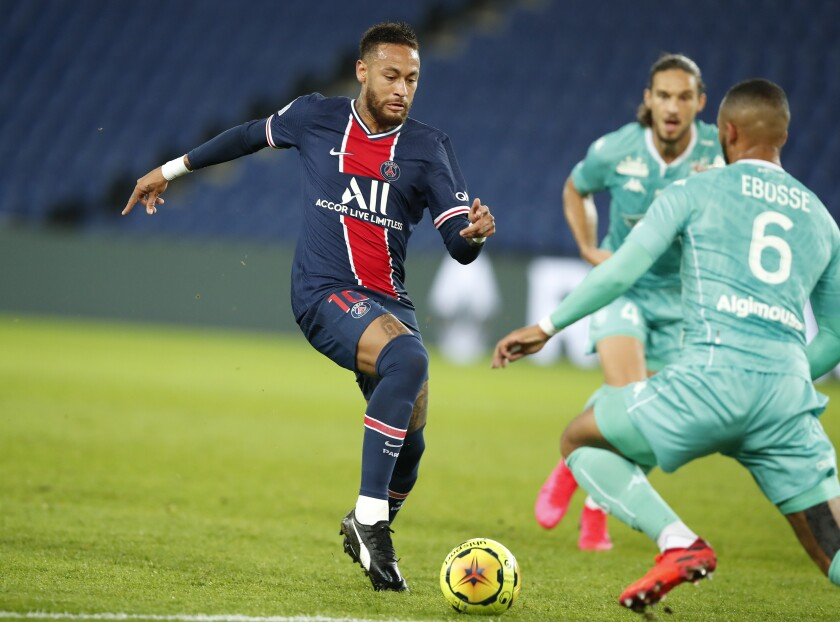 PSG's Neymar, left, battles for the ball with Angers' Enzo Ebosse during the French League One soccer match between Paris Saint-Germain and Angers at the Parc des Princes in Paris, France, Friday, Oct. 2, 2020. (AP Photo/Francois Mori)
