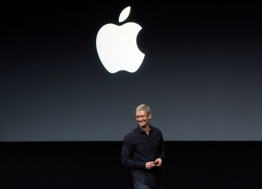 Chief Executive Tim Cook speaking onstage at Apple headquarters last year.