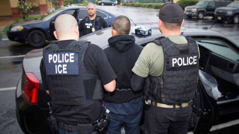 In this photo taken Feb. 7, 2017, released by U.S. Immigration and Customs Enforcement, an arrest is made during a targeted enforcement operation conducted by ICE aimed at immigration fugitives, re-entrants and at-large criminal aliens in Los Angeles.