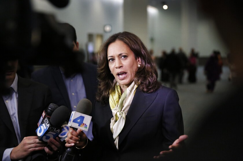 U.S. Senate candidate Kamala Harris talks to media after speaking at the Eid-al Fitr Services hosted by the Islamic Center of Southern California at the L.A. Convention Center in July.