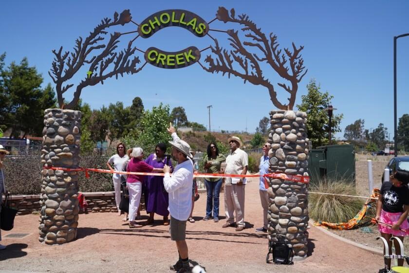 Artist Roman de Salvo discusses his Chollas Creek sculpture at last month's unveiling.