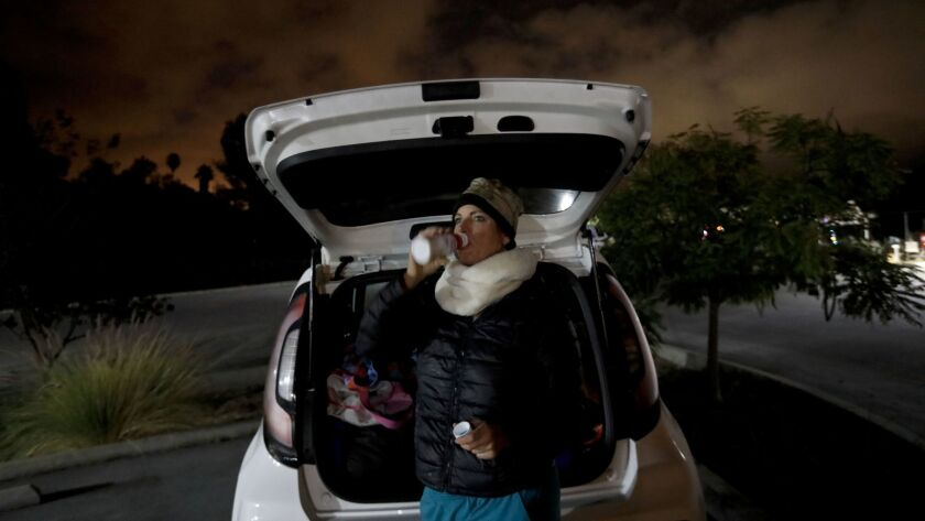 SANTA BARBARA, CA DECEMBER 20, 2017: Marva Ericson, 48, wakes up before sunrise in a Santa Barbar