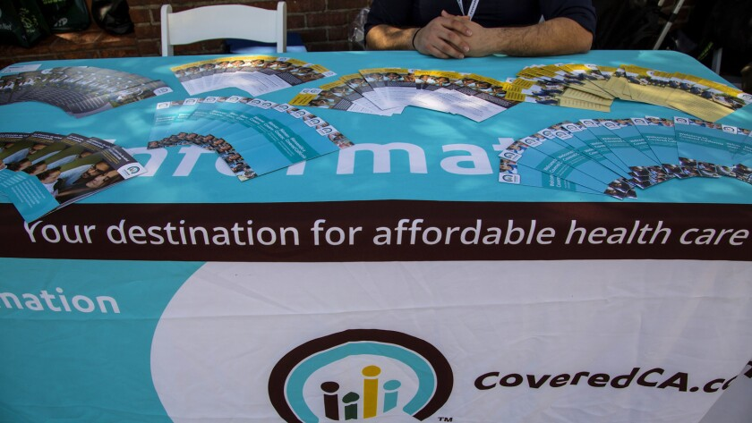 An information table for Covered California at Olvera Street in March. Times).