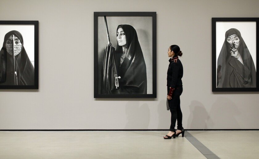 "Shirin Neshat stands before her ""Women of Allah"" series at the Broad"