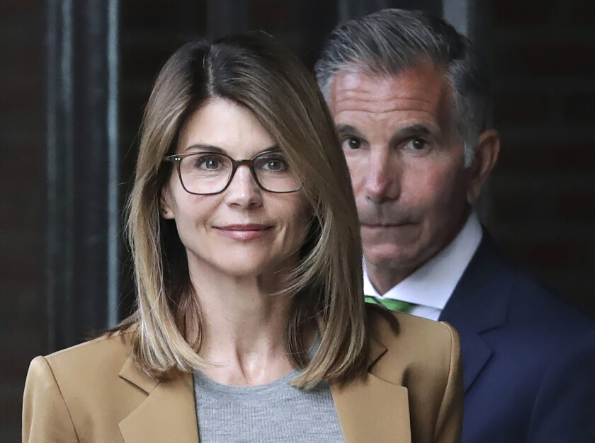 Actress Lori Loughlin and husband Mossimo Giannulli leave a federal courthouse in Boston in April 2019. The couple have agreed to plead guilty in the college admissions scam.