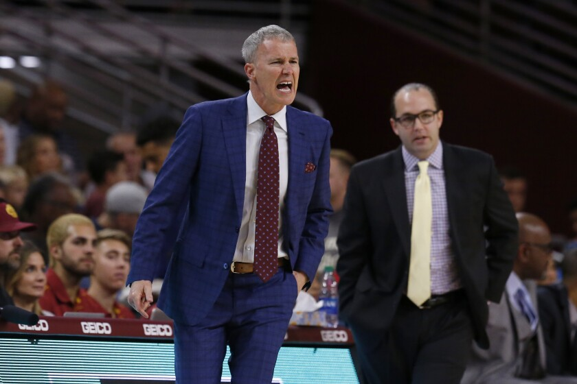 USC coach Andy Enfield argues a foul call against the Trojans during the first half of a game against Utah on Jan. 30 at Galen Center.