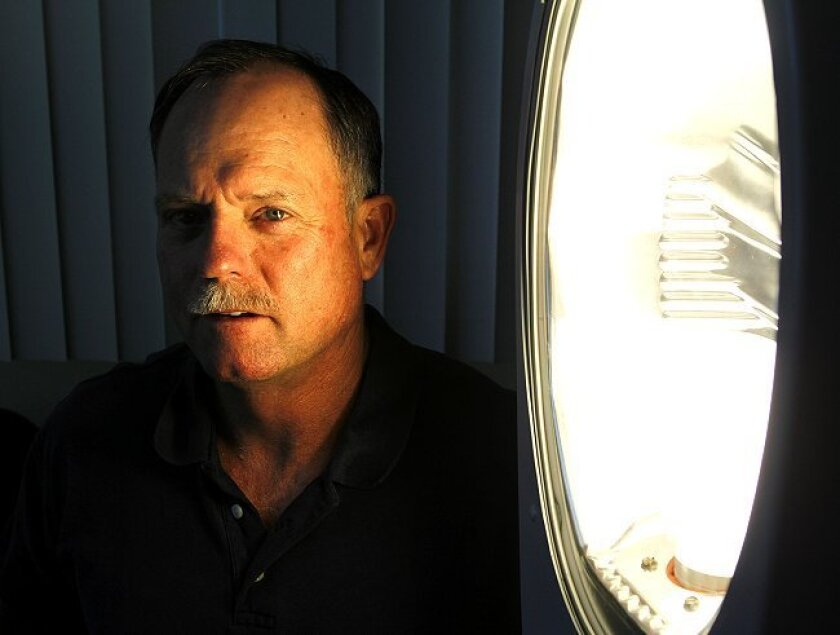 Tom Cartier is spearheading San Diego's streetlight replacement program, which will convert 10,000 lights during the next year.