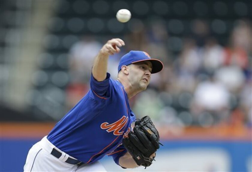New York Mets starting pitcher Dillon Gee delivers against the Colorado Rockies in the first inning of a baseball game in New York, Thursday, Aug. 8, 2013. (AP Photo/Kathy Willens)