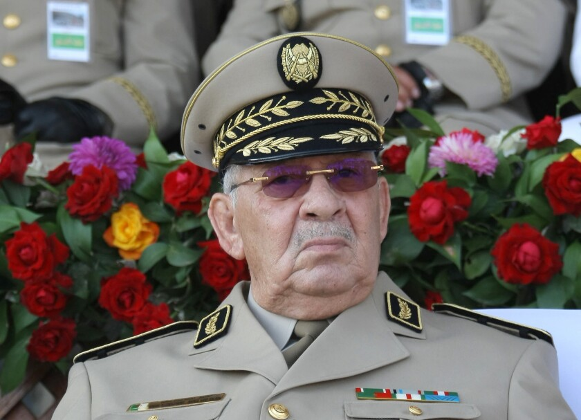 "FILE - In this Sunday, July 1, 2018 file picture Algerian Gen. Ahmed Gaid Salah presides a military parade in Algiers. Algeria's army chief Gen. Ahmed Gaid Salah has ordered Wednesday Sept.18, 2019 gendarmes to block and seize vehicles heading into the capital for weekly demonstrations against the power-structure, claiming that some come with ""malicious intentions"". (AP Photo/Anis Belghoul, File)"