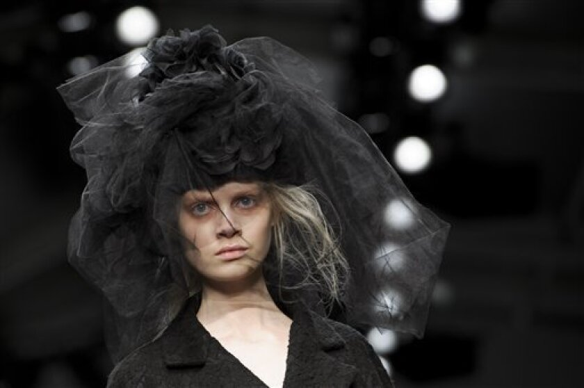 A model wears a design from the John Rocha collection during London Fashion Week, Saturday, Feb. 16, 2013. (Photo by Jonathan Short/Invision/AP)