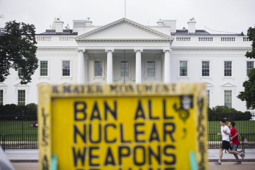 A sign outside the White House expresses one view after President Obama spoke to the nation about the Iran nuclear deal.