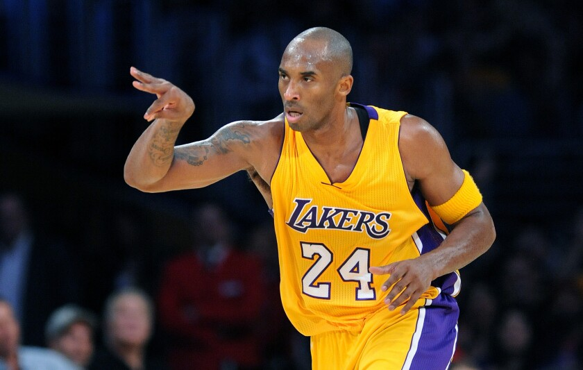 Lakers guard Kobe Bryant celebrates after making a three-pointer against the Timberwolves in the first half Wednesday night at Staples Center. Bryant was just three of 13 from long range as the Lakers lost, 112-111.