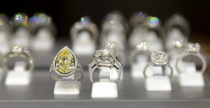 Custom-made and -designed engagement rings on display at Charles Koll Jewellers.