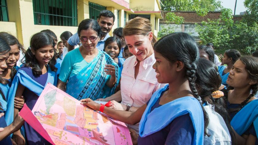 Melinda Gates receives gifts from students during her visit to Sudha Varghese's Prerna School for gi