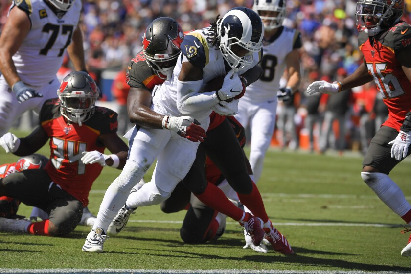 Rams running back Todd Gurley scores past the Tampa Bay Buccaneers during the first on Sunday at the Coliseum.