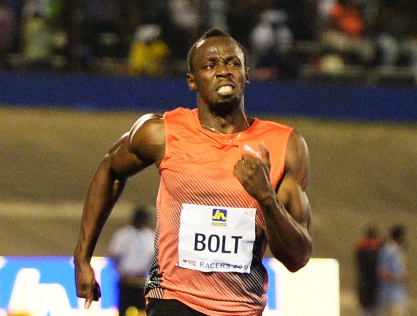 FILE - In this June 11, 2016, file photo, Usain Bolt, of Jamaica, wins the 100-meter final ahead of Yohan Blake and Asafa Powell, both of Jamaica, in the Racers Grand Prix track and field event at the National Stadium in Kingston, Jamaica. Even if fully fit, Bolt, the world record-holder and two-time defending champion in the 100- and 200-meter sprints, will have plenty of competition. in Rio. (AP Photo/Collin Reid, File)