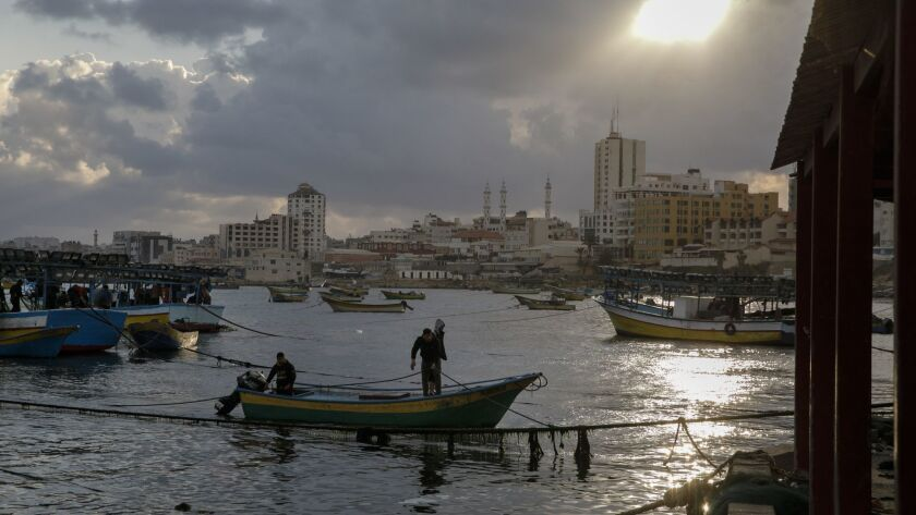 Mahmud Abu Riyala returns to the Port of Gaza after a day fishing off the coast of Gaza. His cousin