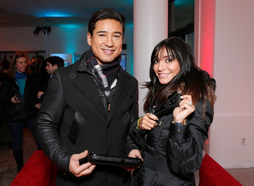 Mario Lopez, left, and Courtney Laine Mazza warm up at the Sundance Film Festival in January. They are expecting their second child.