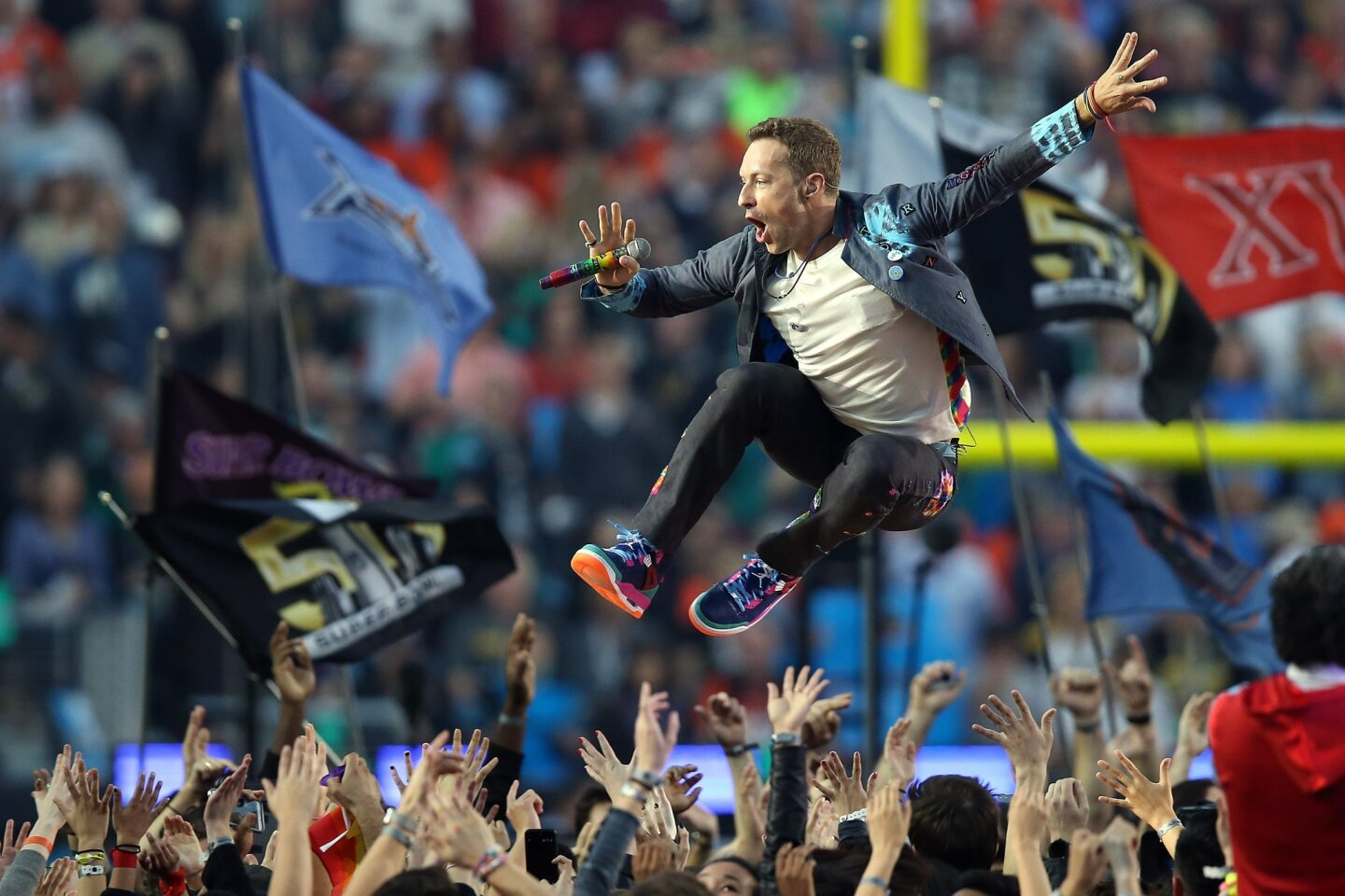 Feb 7, 2016; Santa Clara, CA, USA; Coldplay singer Chris Martin performs during halftime in Super Bowl 50 at Levi's Stadium. Mandatory Credit: Cary Edmondson-USA TODAY Sports ** Usable by SD ONLY **