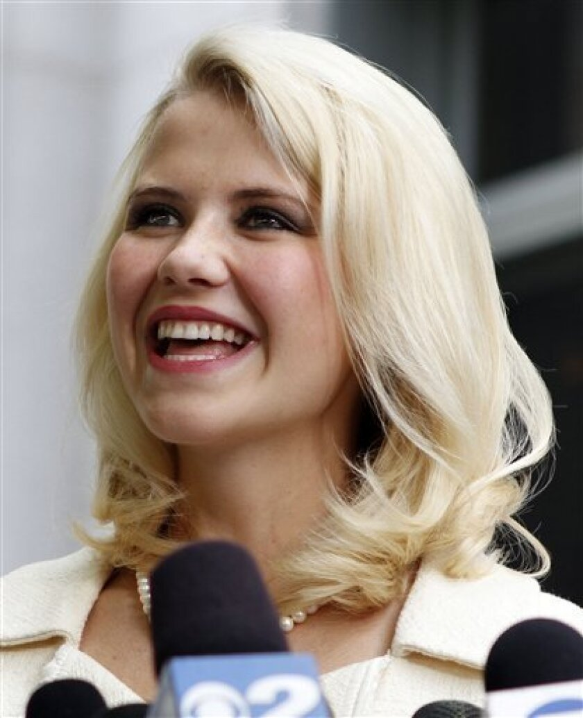 FILE - This May 25, 2011 file photo shows Elizabeth Smart talking to the media in front of the Frank E. Moss Federal Courthouse in Salt Lake City.  Smart who was kidnapped, raped and held captive at age 14 by a Salt Lake City street preacher is taking a job as a commentator for ABC News.   ABC spok