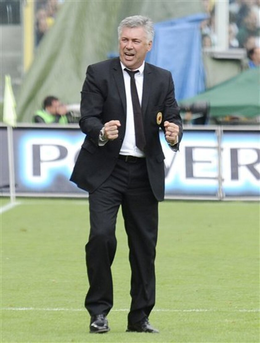 AC Milan coach Carlo Ancelotti  reacts during an Italian Serie A soccer match between Fiorentina and Milan, at the Artemio Franchi stadium in Florence, Italy, Sunday, May 31, 2009. Ancelotti announced this was his last match on AC Milan bench. (AP Photo/Lorenzo Galassi)