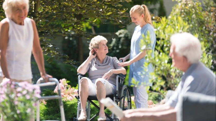 Disabled elderly woman in garden