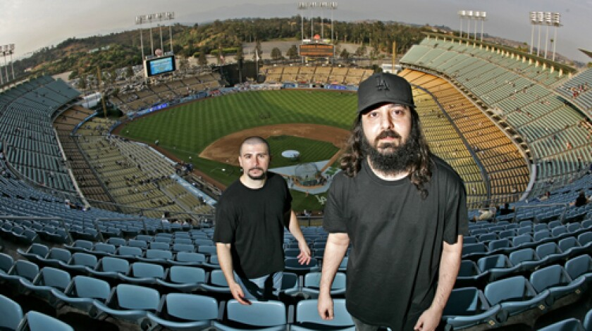 FIELD OF ENDEAVOR: System of a Down's John Dolmayan, left, and Daron Malakian lead Scars on Broadway, whose debut album arrives Tuesday.