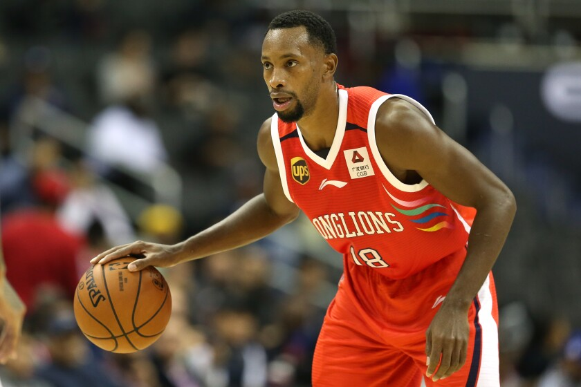 Kyle Fogg brings the ball up court for the Guangzhou Long-Lions during an exhibition game against the Washington Wizards on Oct. 12, 2018.