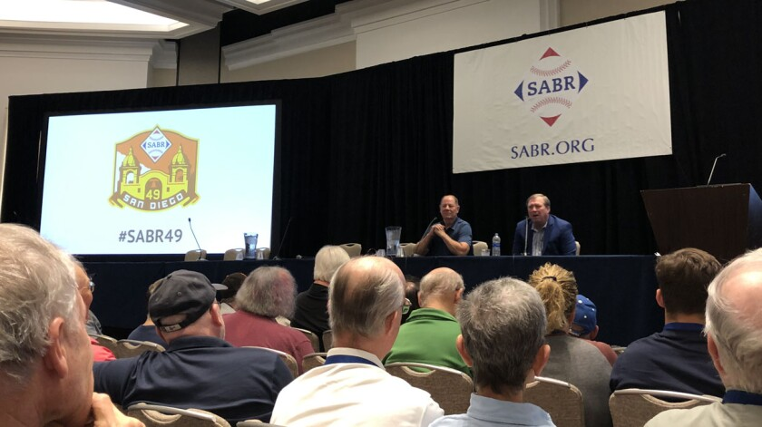 Former MLB executive Mike Port (left) and current umpire Gerry Davis were the featured speakers on Saturday morning for the umpiring panel at the 49th annual SABR convention held downtown at the Manchester Grand Hyatt San Diego.