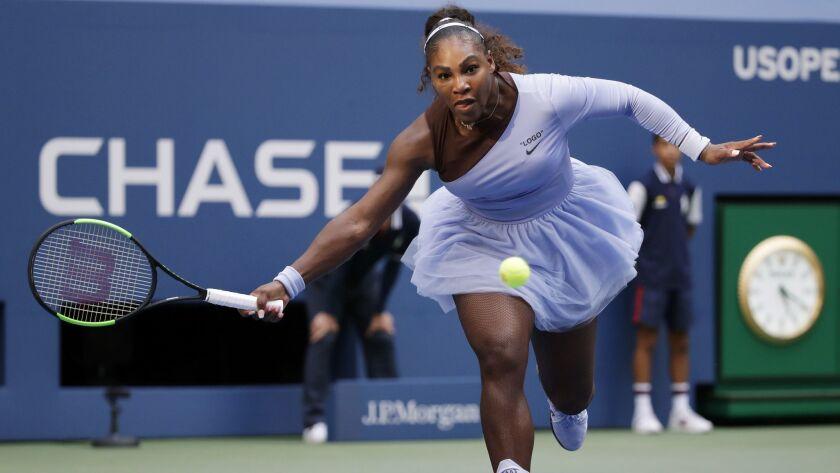 Serena Williams returns a shot Kaia Kanepi, of Estonia, during the fourth round of the U.S. Open ten