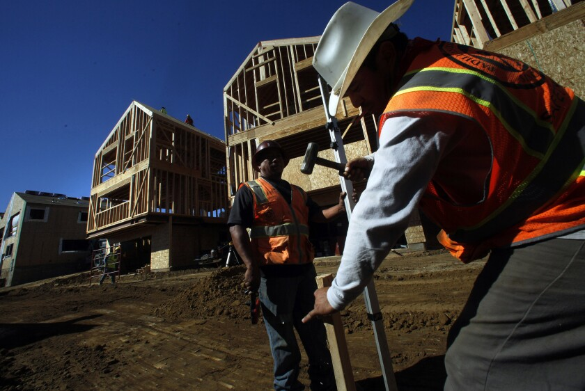 Construction workers build housing in Los Angeles