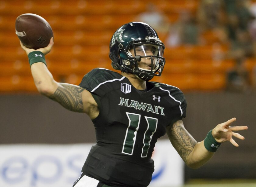 Hawaii quarterback Ikaika Woolsey (11) throws a pass late in the in the fourth quarter of an NCAA college football game, Saturday, Sept. 6, 2014, in Honolulu. Oregon State beats Hawaii 38-30. (AP Photo/Eugene Tanner)