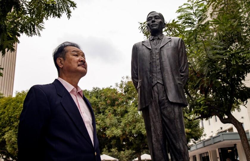UC Riverside professor Edward Taehan Chang stands near the statue of Dosan Ahn Chang Ho.