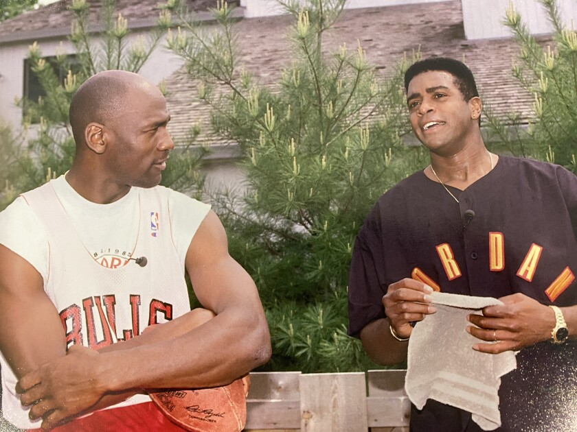 """Michael Jordan, left, with broadcaster Ahmad Rashad. Rashad's 1993 interview with Jordan about accusations that the basketball star had a gambling problem is featured in ESPN documentary series """"The Last Dance."""""""